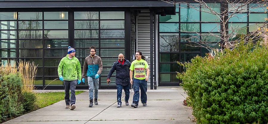 Students walking outside a building on campus