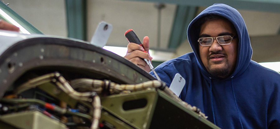 South Seattle College student working in mechanical apprenticeship class