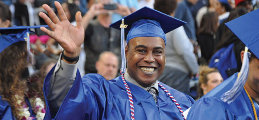 South Seattle College graduate waiving at Commencement