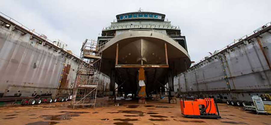 ship in drydock being repaired