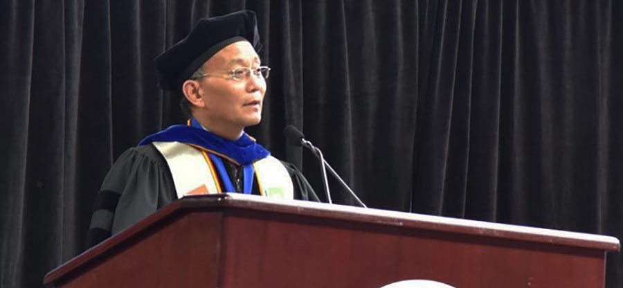 Chancellor Shouan Pan speaking at commencement ceremonies