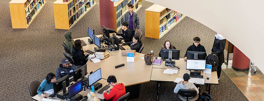South Seattle College students study in the library birds eye view